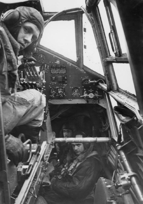 The pilot, navigator and bomb aimer at their positions in a Handley Page Halifax, October 1941.