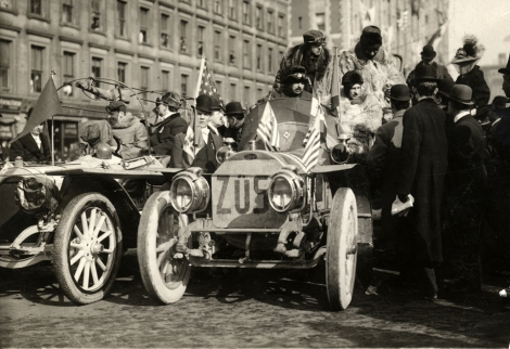 "View of motorists in Zust car during 1908 New York to Paris Race. Group of men stand next to car; Zust car is parked next to Thomas Flyer automobile. Stamped on back: ""Spooner and Wells, 1931 Broadway, New York, duplicates any time, enlargements all sizes, tel. 3472-3473 Col., credit appreciated."" Handwritten on back: ""Races and racing--New York to Paris Race, 1908."" DPL"