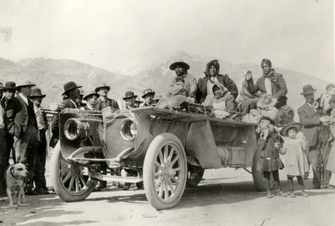 "View of American Indian men and women posing in Thomas Flyer car near Cherry Creek, Nevada during 1908 New York to Paris Race. Typed on back: ""Indians near Cherry Creek, Nevada, got a ride in the Thomas Flyer which was on the 1908 New York-to-Paris race. Also see L-353."" Handwritten on back: ""Races and racing--New York to Paris, 1908."""